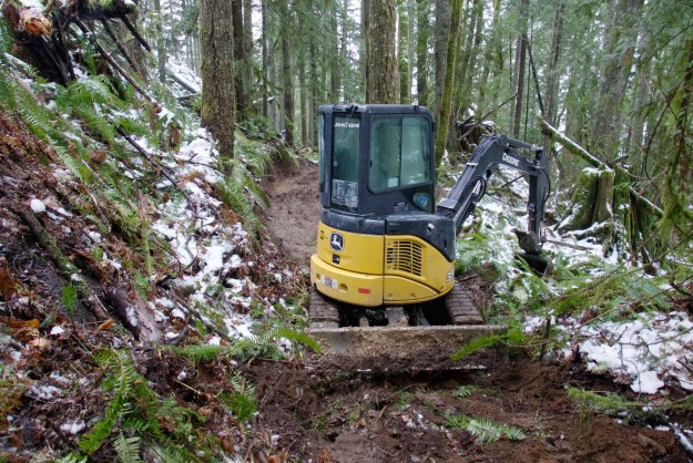 Excavator that's handling the initial trail rough-in